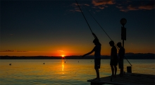 <h5>Sunset Fishing Lake Garda by Nigel Hart</h5>
